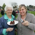 May and Jackie Calder try some of the cakes
