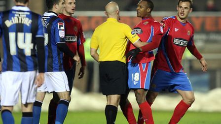 Gavin Hoyte of Dagenham is dragged away from Rochdale' player Robert Grant (Pic:DaveSimpson/TGSPHOTO