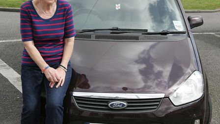 Pam with her maroon Ford C-Max, a different model and car to the vehicle shown above