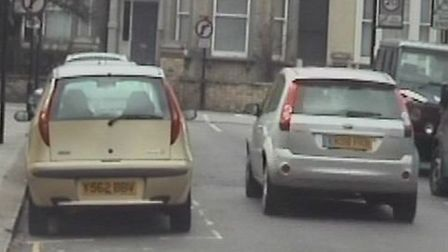 """The silver Ford approaches the turn clearly marked with """"no right turn"""" signposts"""