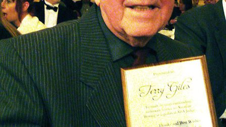 Terry Giles with his long service award.