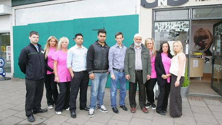 Business owners and residents who are against Paddy Power's plans standing outside the empty unit in