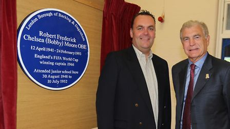 The plaque in memory of Bobby Moore with Cllr Liam Smith (left) and Sir Trevor Brooking