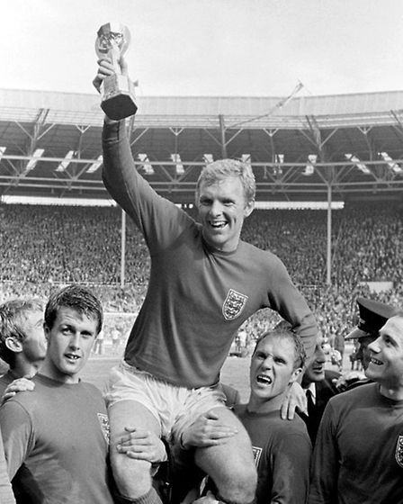 Bobby Moore lifting the World Cup on the shoulders of his England teammates