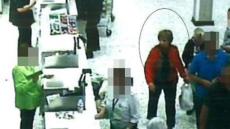 The woman circled in the attached CCTV still is wanted for questioning by Police