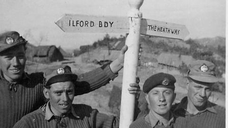 Soldiers in Korea, 1954, with a sign to the Heathway. So many Dagenham lads were called up for Natio