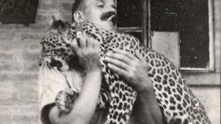 The Leopard mascot of A Company, 1st/4th Battalion, in Sierra Leona in 1941 pictured with Company Se