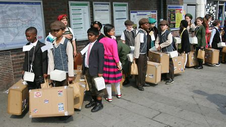 Pupils and staff from St Joseph's school at Dagenham Heathway Station about to board a tube train