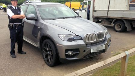 A BMW that was seized by police for not having insurance.
