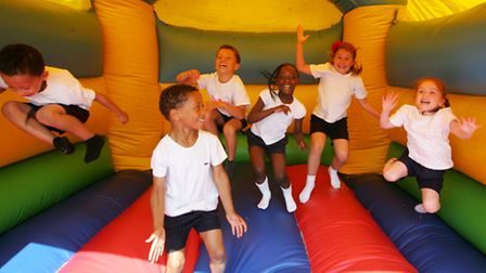 Children having fun on the bouncy castle at one of the fun days