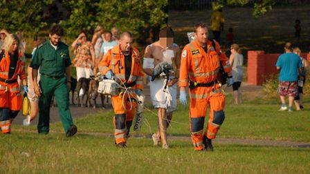 The man being led by paramedics to the air ambulance in Goresbrook Park, Dagenham. Picture taken by