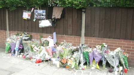 Flowers left at the scene of the crash in 2011
