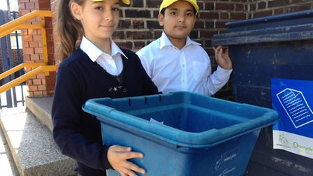 Ripple Primary School energy monitors Maria Dimitrova and Ibteesam Qureshi with one of the blue boxe