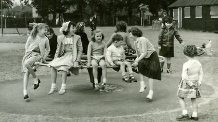 Children playing on a roundabout at St Chads park in 1958