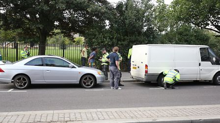 Police stopping cars as part of Operation Cubo