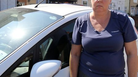 Linda Oliver, who is battling breast cancer, with her car.