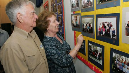 Former members of staff John and Joyce Ferguson look at a display about the school's centenary