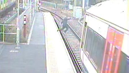CCTV footage from Barking station shows the man jumping onto the tracks in front of a moving train