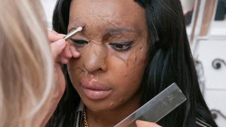 Debra Robson draws on the outline of Naomi's new eyebrows