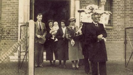 Henry West conducting a child's funeral in 1940