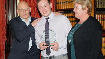 Matthew at the presentation with his parents