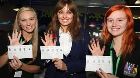Carol Vorderman takes fingerprints with Students Sherie Bailey and Emma Wilson