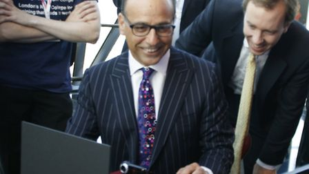Theo Paphitis having a go at stop-motion animation, watched by Matthew Hancock MP, and being guided