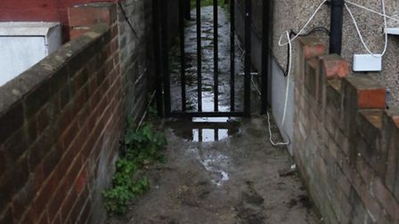 One of the alleyway between two houses, which residents said are used by prostitutes, littered with
