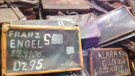 Suitcases still bearing the names of families who were killed at Auschwitz