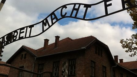 The gate to Auschwitz One with an inscription which reads 'arbeit macht frei' (work sets you free).