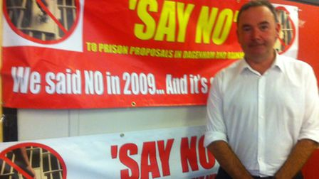Jon Cruddas in front of his prison campaign banners.