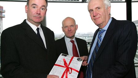 Jon Cruddas MP and John Biggs AM hand the petition to deputy mayor for policy and planning Sir Edwar