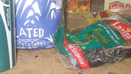 Photograph of mice droppings on shelf in store room next to food posing risk of cross contamination