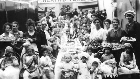 Women and children at a street party to celebrate the end of the war on Heath Street in 1918