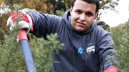 An NCS participant on a community volunteer gardening day (photo; Adam Hollingworth)