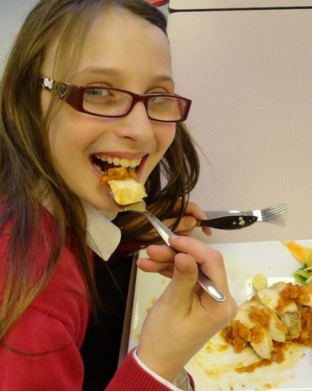 Emily Millis tucks into one of Adrienne Williams' dishes