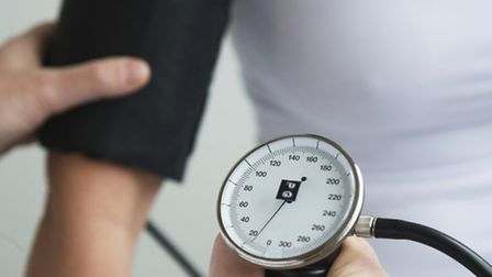 A woman gets her blood pressure checked