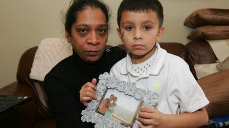 Patricia Moses, sister-in-law of Christopher Ritchie, with six-year-old son Ethan