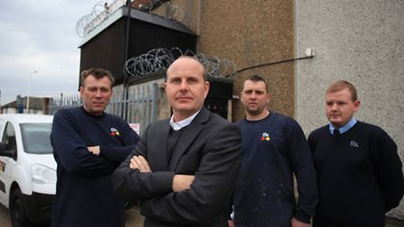 Director Paul Cunningham and his staff, of Fix Auto Dagenham, stand angry after the business suffere