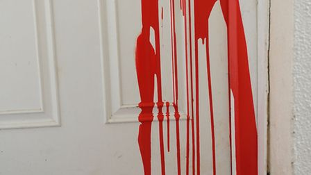 Paint was poured inside a block of flats after the door was left open
