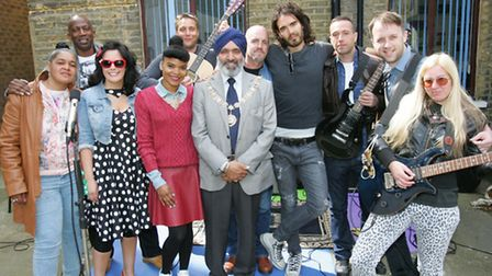 Mayor cllr Hardial Singh Rai and Russell Brand on stage with the band