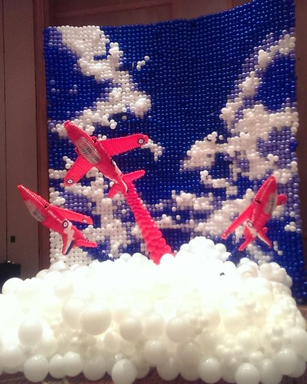 Lucy Hennessy spent 27 hours creating a Red Arrows sculpture using 27,000 balloons, as part of 12-pe