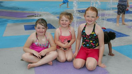 Angel, Skye and Autumn Ward cool off at the splash park in Barking on Saturday