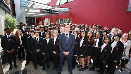 Eastbury Comprehensive School headmaster David Dickson (centre) surrounded by pupils and staff.