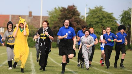 Students, of Sydney Russell School, run to raise money for local charity.