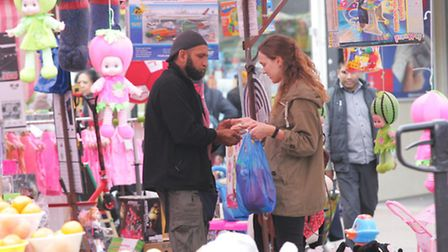 Another market trader Rashid Suleman unknowingly sells a dangerous doll to Post reporter Anna Dubois