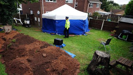 The scene in the Wycherleys' former back garden as their bodies were exhumed. Picture: Rui Vieira/PA