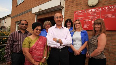 Dr K Alkaisy, centre, and the staff at Urswick Medical Centre celebrate a five-star rating.