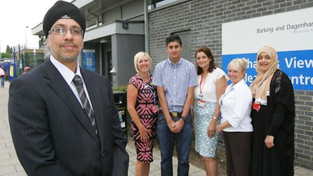DR Gurkirit Kalkat with staff members outside his highly-rated surgery