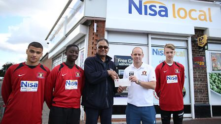 Nisa Supermarket owner Kirit Patel (centre) presenting a cheque for �1,000 to Westhamians FC first t
